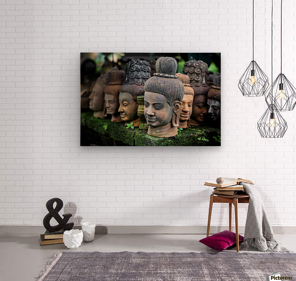 Heads of statues of Buddha are stacked in a terra-cotta factory; Chiang Mai, Thailand  Wood print