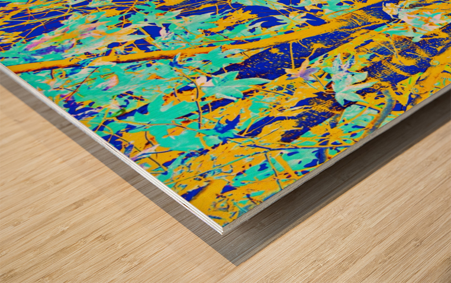 green maple tree leaf with blue and yellow abstract background Wood print