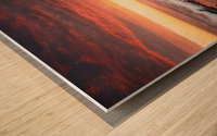 Sunset over rocky coastline Wood print