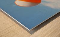Beach ball on top of cloud Wood print