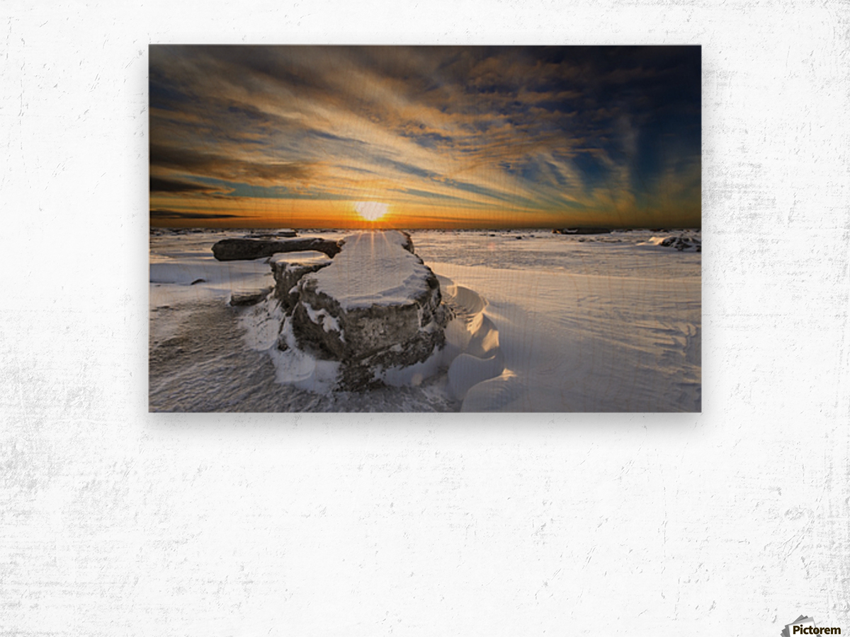 A large ice block on frozen Turnagain Arm at sunset; Anchorage, Alaska, United States of America Wood print