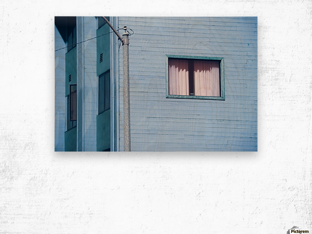 vintage blue wood building with window and electric pole Wood print