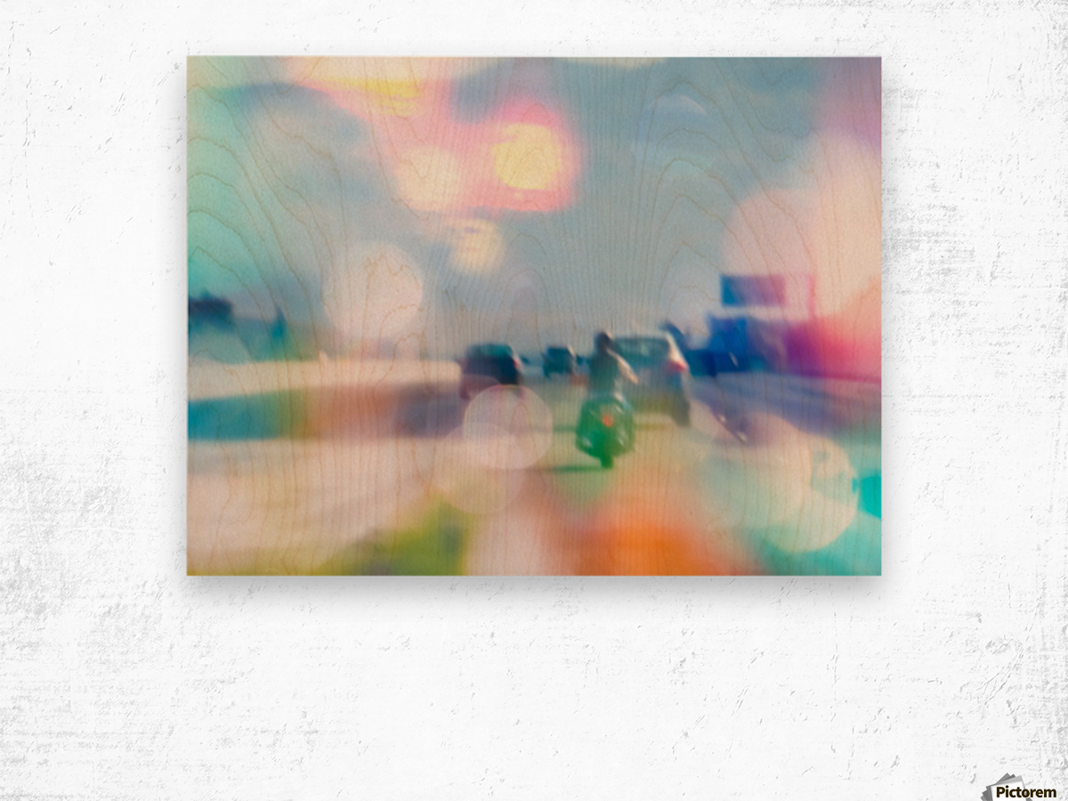 car and motorcycle on the road in the city with bokeh light Wood print