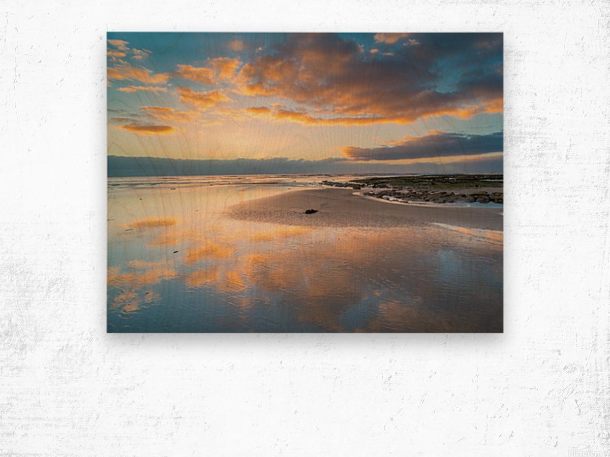 Beach sunrise reflected on the wet sand Wood print
