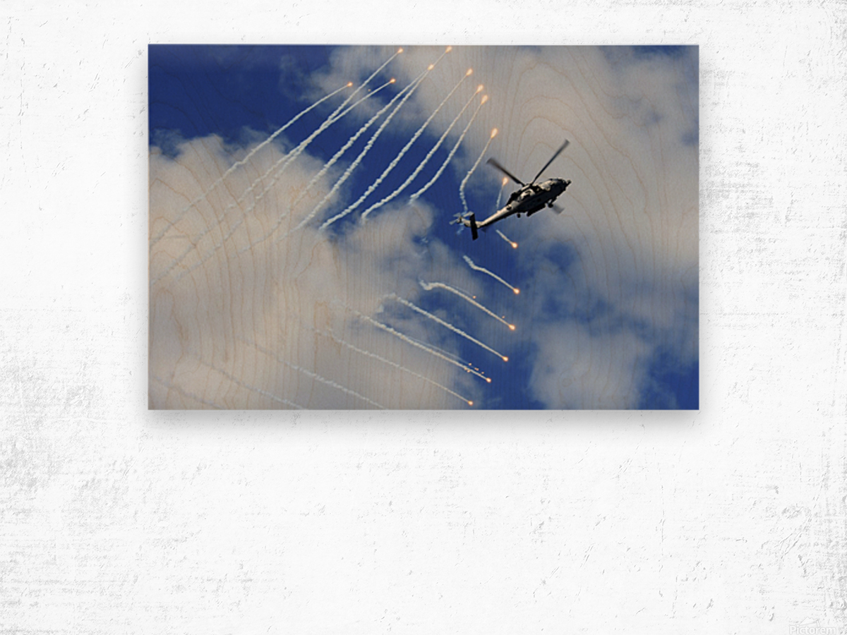 An HH-60H Sea Hawk helicopter releases countermeasure flares. Wood print