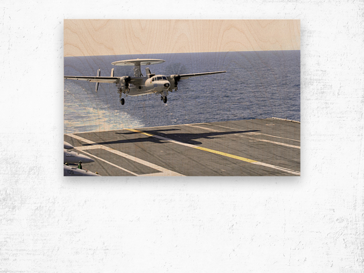 An E-2C Hawkeye makes its approach to the flight deck of USS Dwight D. Eisenhower. Wood print