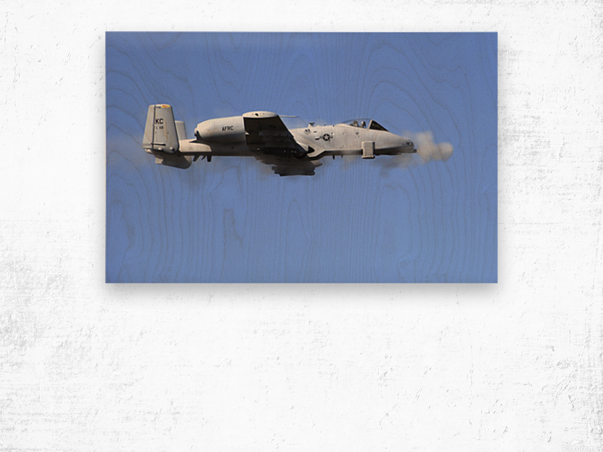 A pilot in an A-10 Thunderbolt II fires the planes 30-mm cannon. Wood print