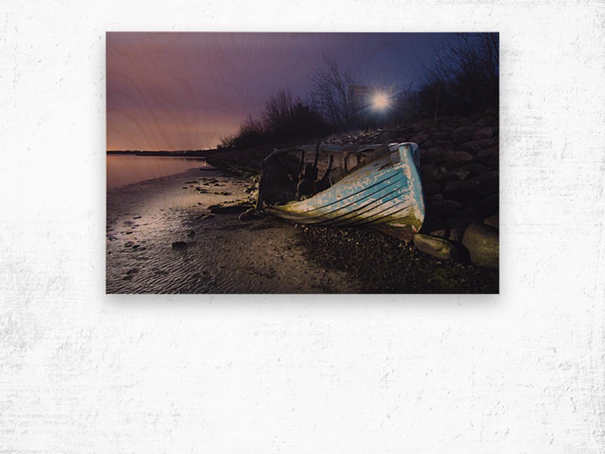 Old boat on Copenhagen shore at night  Wood print