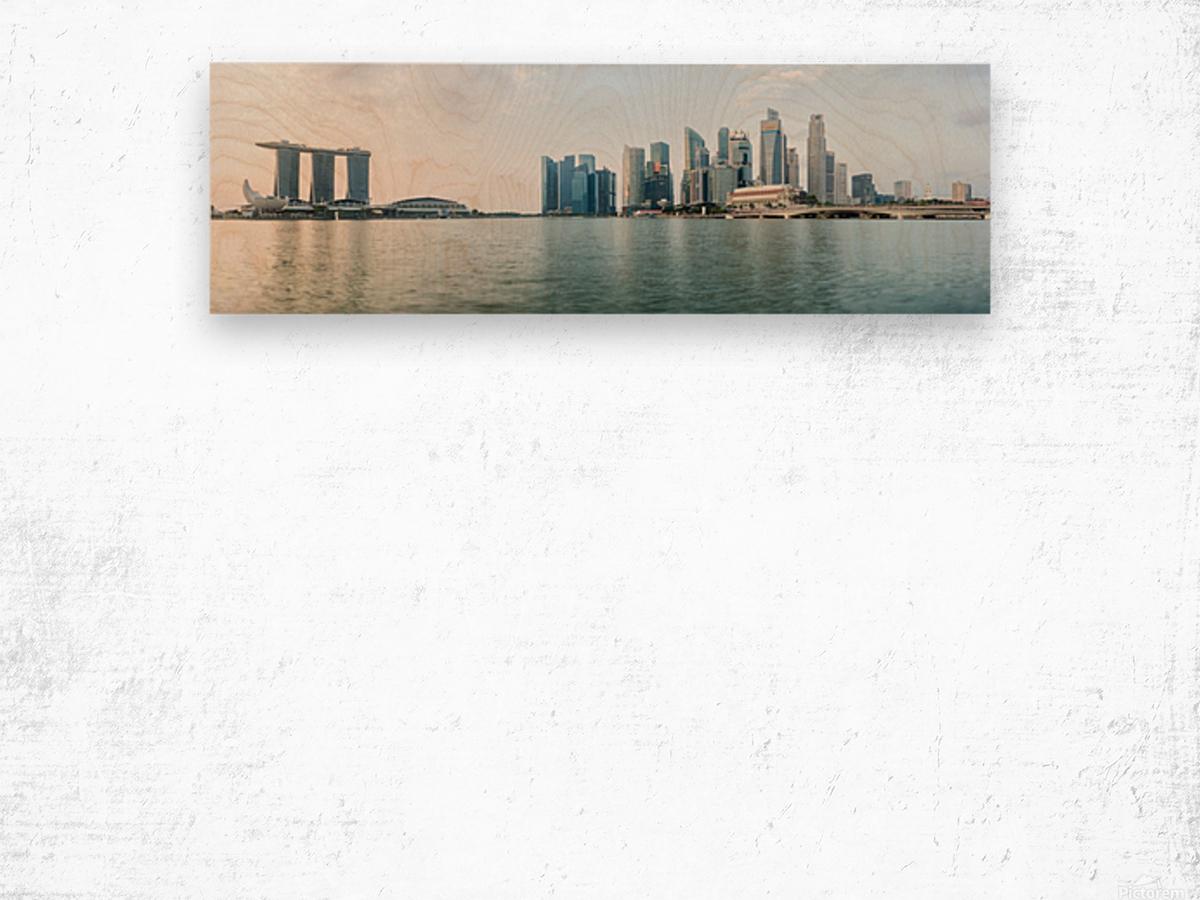 Panorama of Singapore skyline at sunrise Wood print
