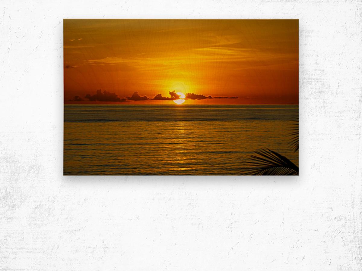 Sun rising on the ocean Wood print