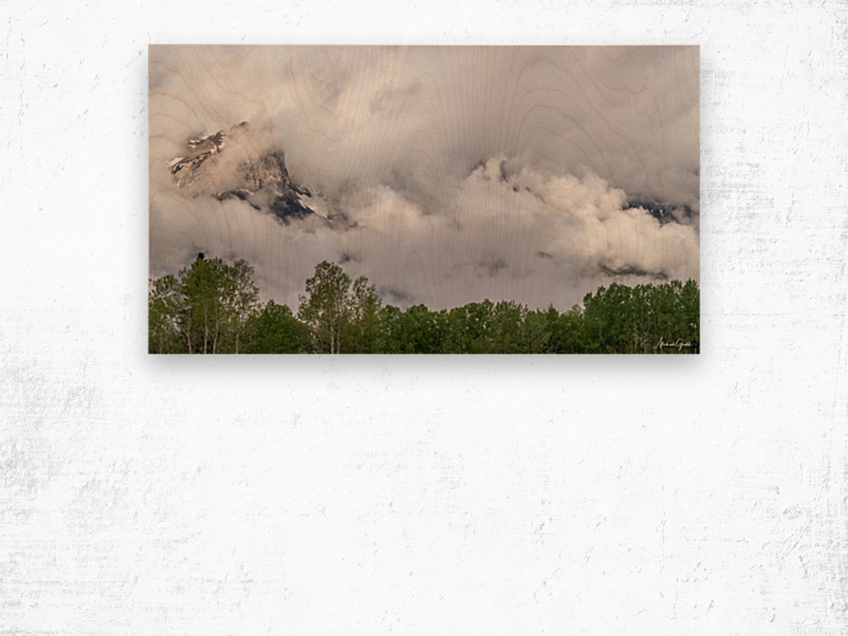 Billowy Clouds Surround Rundle Mountain Wood print