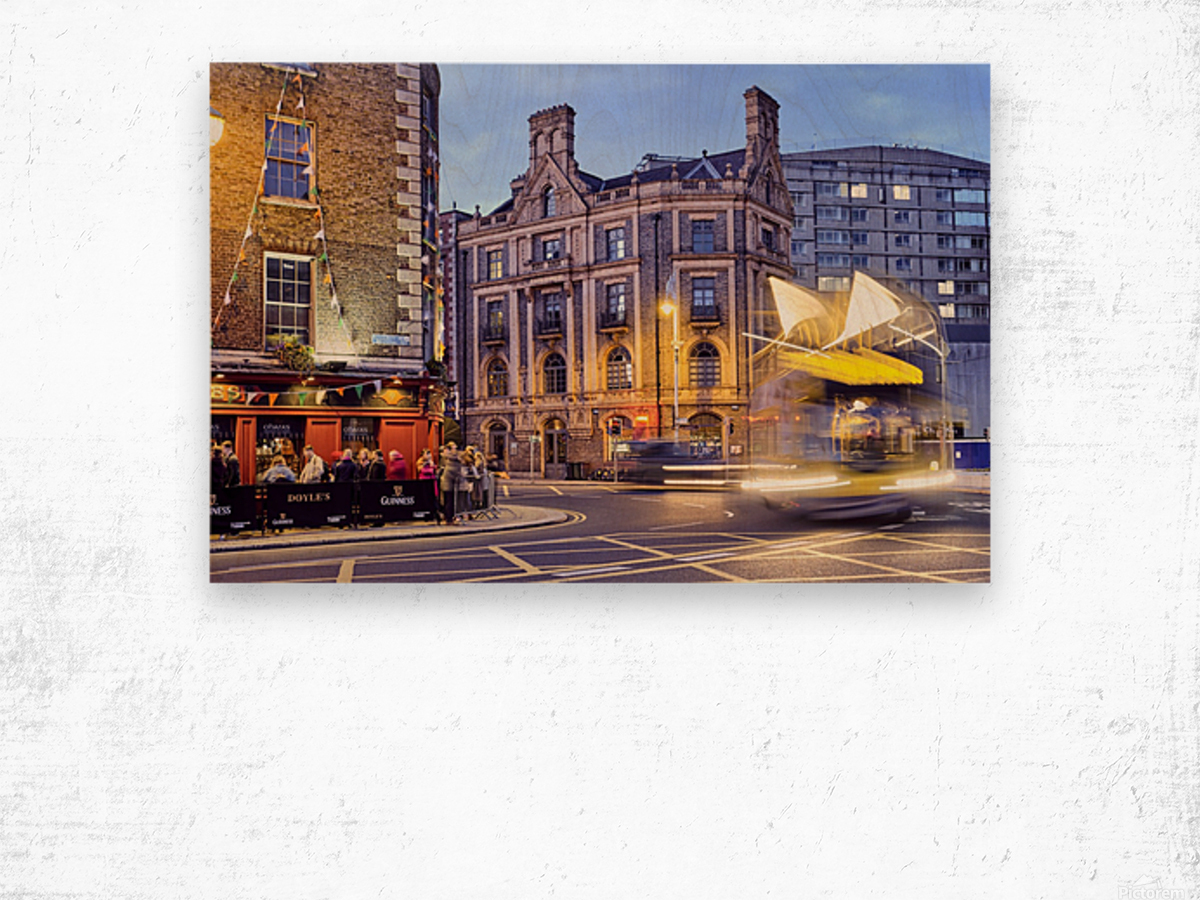 City street with people outside of pub at night Dublin Ireland Wood print