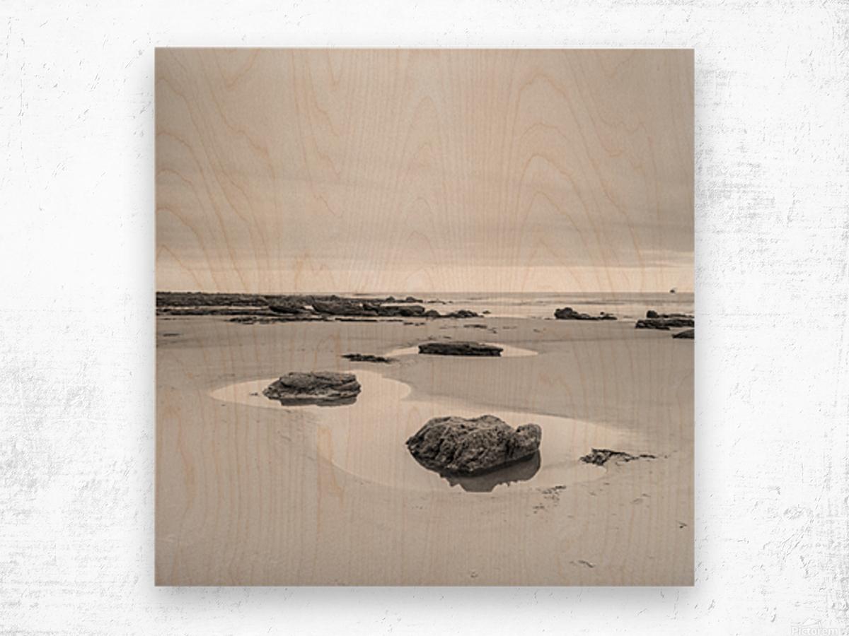 Rock pools on a sandy beach Wood print