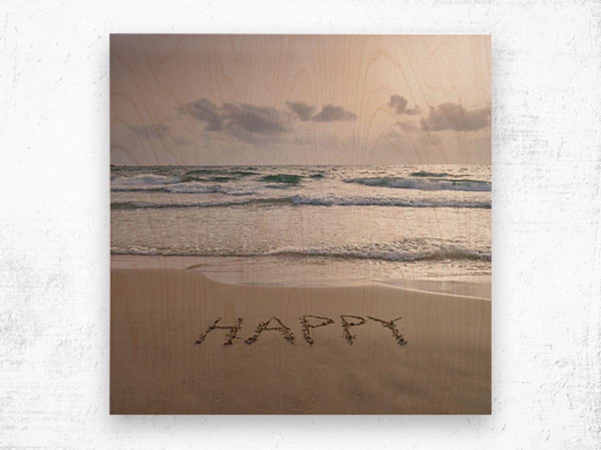 Sand writing - Word Happy written on beach Wood print