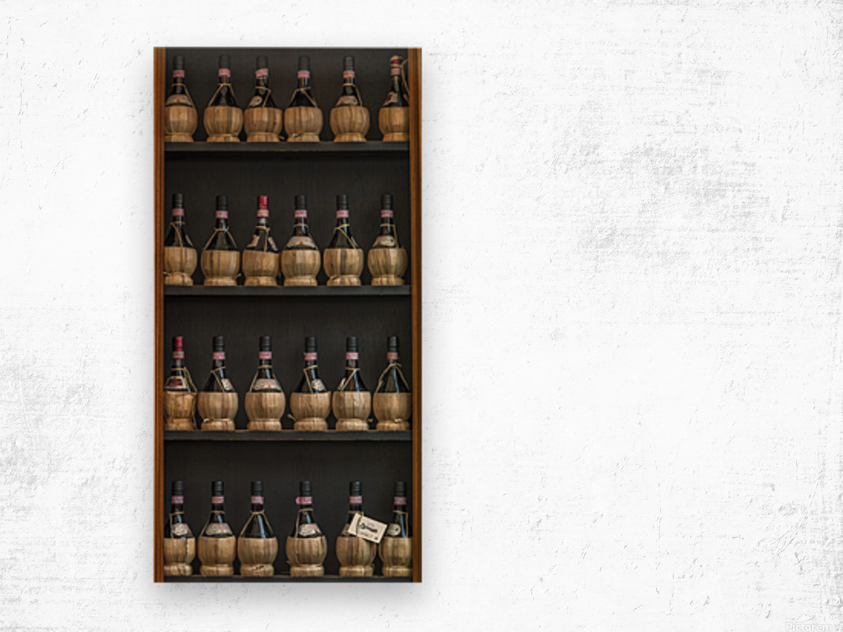 Old wine bottles on wooden shelf Wood print