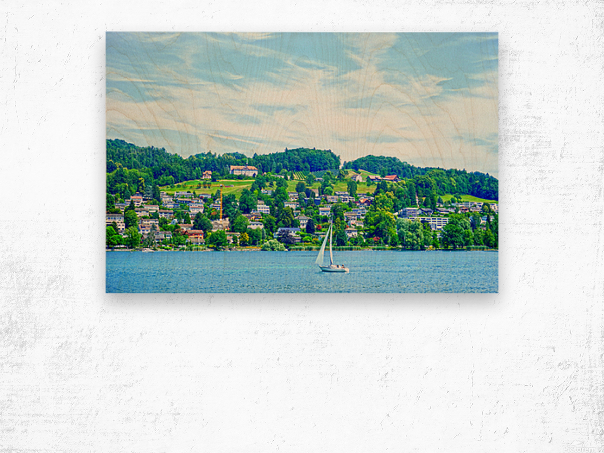 Sailboat On Lake Lucerne with Alpine Village in Background Wood print