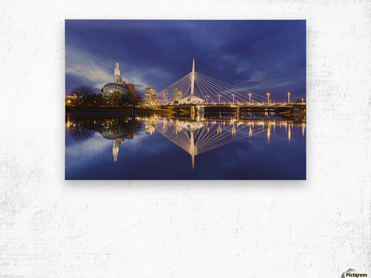 Canadian Museum for Human Rights and Esplanade Riel bridge reflected in the Red River; Winnipeg, Manitoba, Canada Wood print