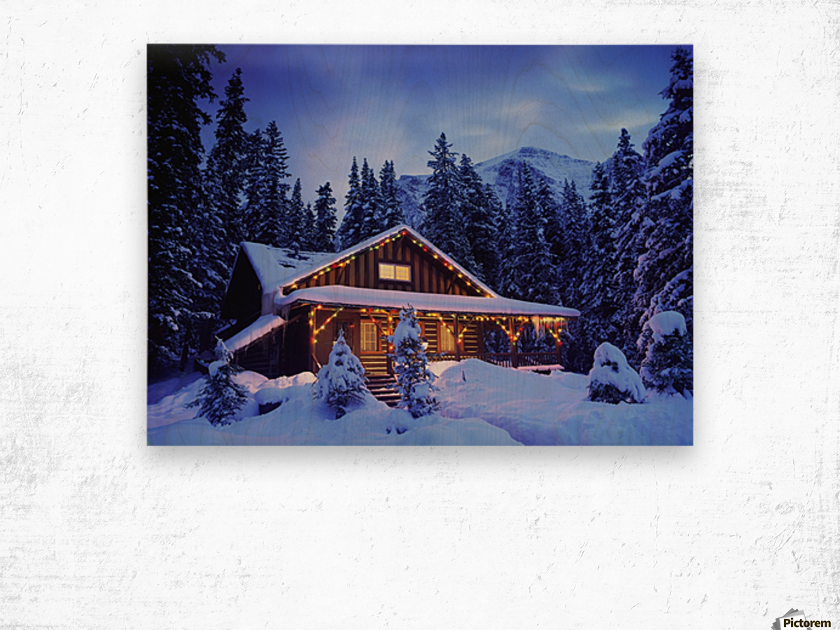 Cabin in the woods illuminated by Christmas lights Wood print