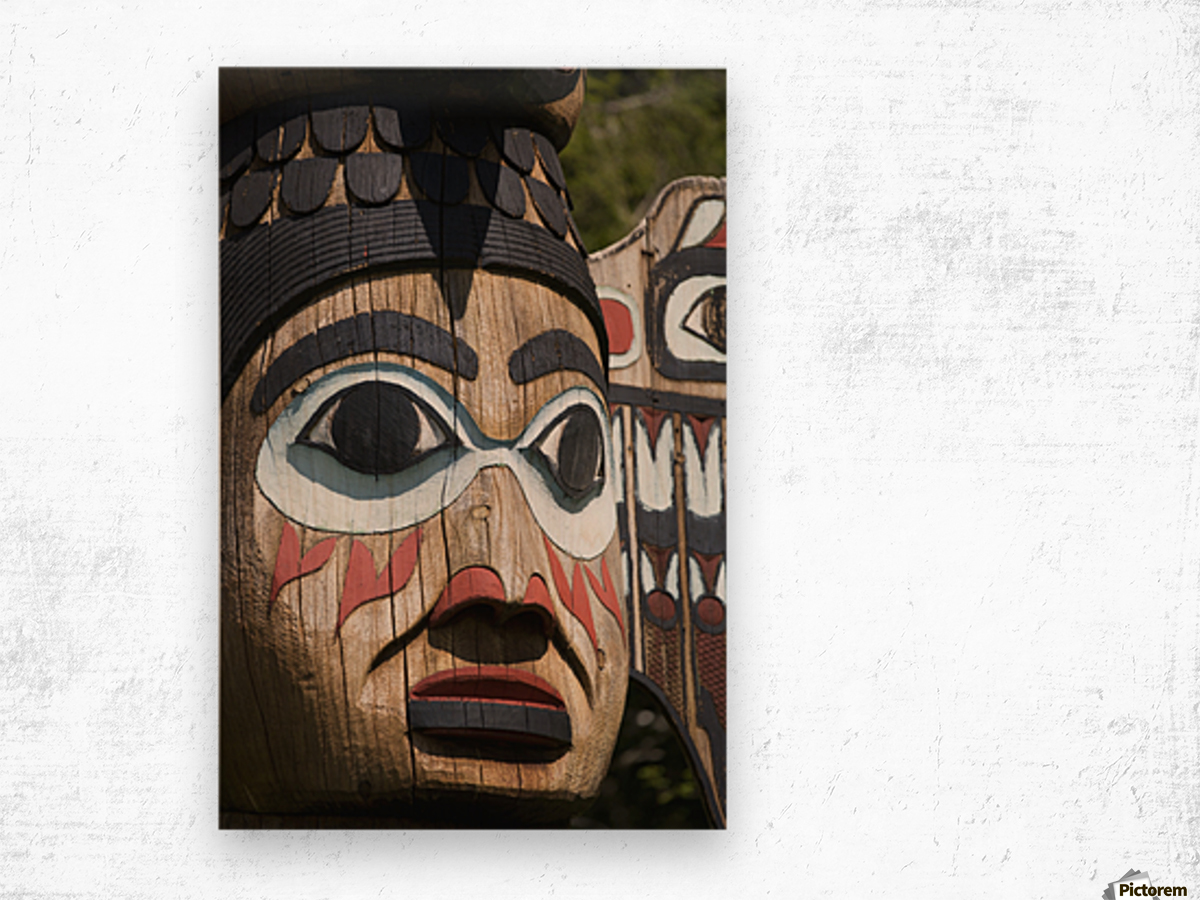 Detail of a figure carved into a Totem Pole, Totem Bight State Historical Park, Ketchikan, Southeast Alaska, USA, Spring Wood print