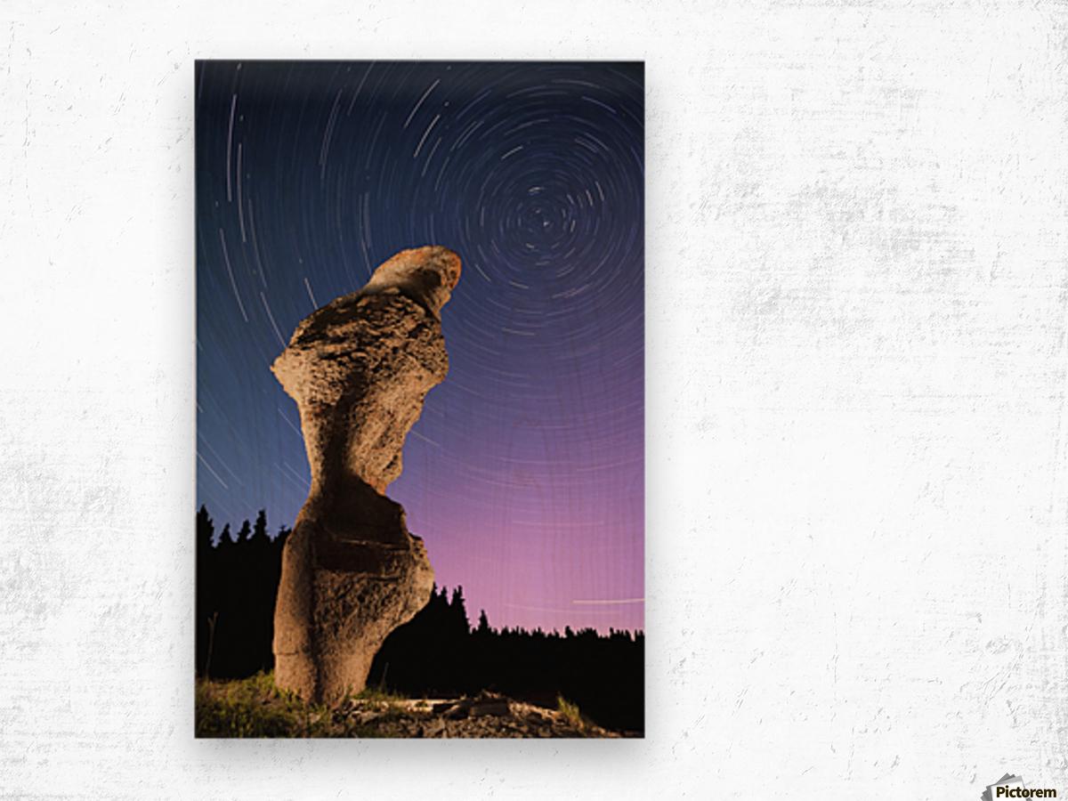 Light painting on monolith and star trails, Anse des Bonnes Femmes at Ile Niapiskau, Mingan Archipelago National Park Reserve of Canada, Cote-Nord, Duplessis region; Quebec, Canada Wood print