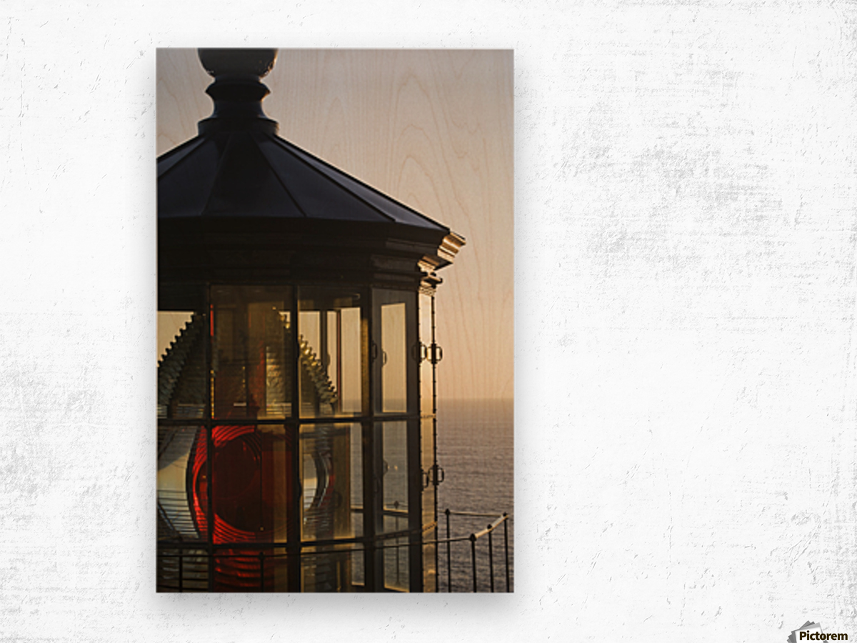 The sun sets at Cape Meares Lighthouse; Oregon, United States of America Wood print