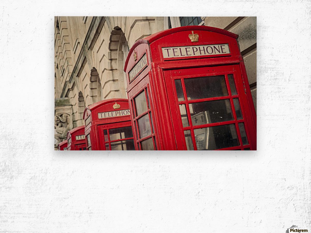 Telephone boxes in a row; Blackpool, Lancashire, England Wood print